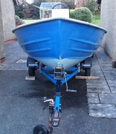 Centre console, Wheel steered Dinghy with 25hp Mariner Outboard and Road Trailer.