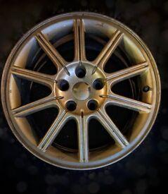 17 inch genuine Subaru Impreza STi gold alloy wheel