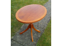 YEW/MAPLE EFFECT OVAL DRINKS/CONSOLE TABLE WITH FOLDING TOP.