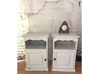 A PAIR OF PINE PAINTED BEDSIDE CABINETS / CUPBOARDS