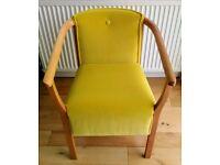 Vintage armchair upholstered in yellow velvet