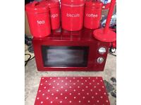 Red kitchen microwave and accessories