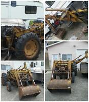 Tractor with loader and backhoe