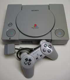 playstation grey model with ps1 controllers/mains lead/power lead 4 ps1 memory cards/ tons of games