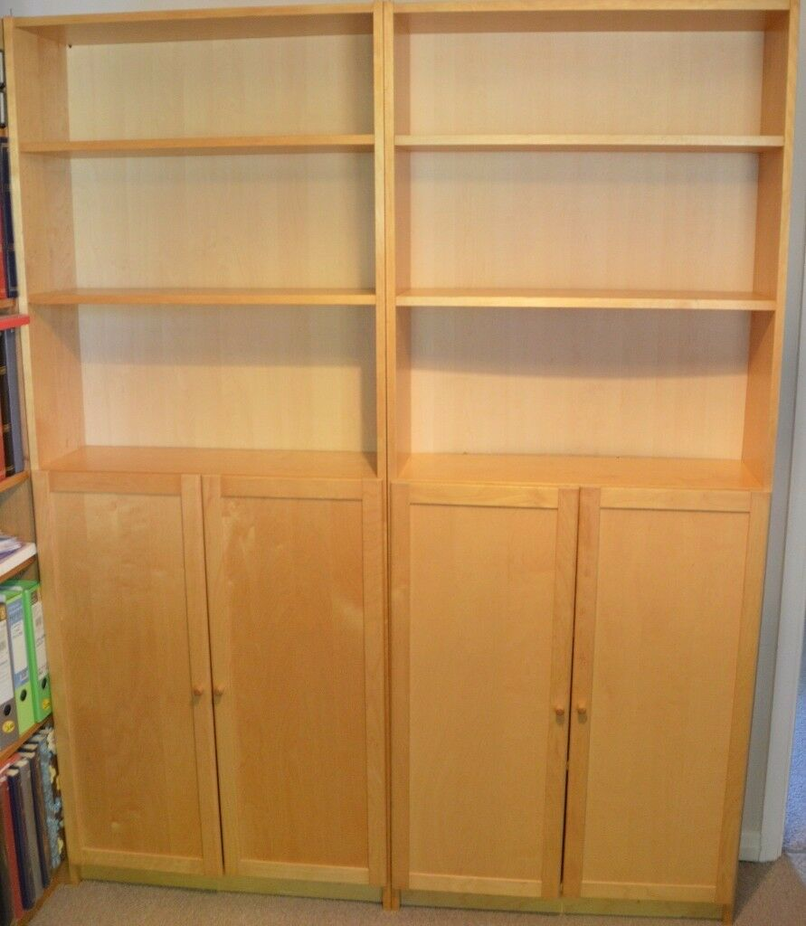 Two Ikea Billy Bookcases in Birch Finish with Oxberg Doors