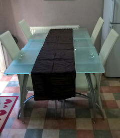 A good quality tempered glass table & 6 faux leather chairs