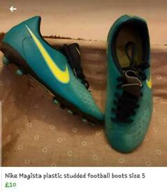 Size 5, plastic studded football boots