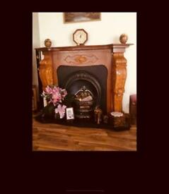 Oak effect fire surround and cast iron horseshoe back and grate