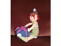 Handmade crochet Christmas elf doll with parcel.