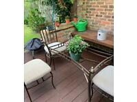 4 Wrought Iron chairs & table. (Missing glass) ONO