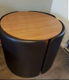 Space saving table and storage chairs