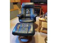 Daneway Dark Blue Leather Swivel Recliner Chair and Footstool