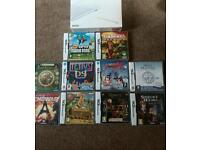 DS in box with 10 games, all boxed