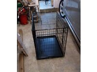 Black metal dog crate