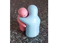 Blue and pink ceramic salt and pepper set.