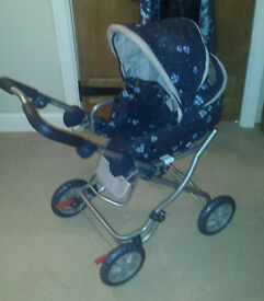 Dark blue pushchair suit up to 2 years.