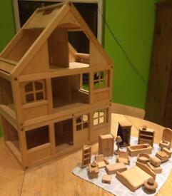 Wooden Scandinavian-style dolls house with furniture