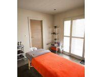 Male sports massage therapist