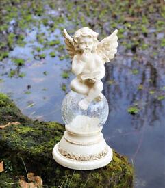 Solar Powered Angel On The Globe Garden Ornament