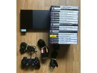 PlayStation 2 slim console and lots of games. Ps2