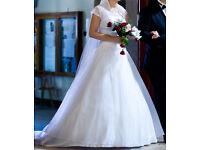 Beautiful wedding dress, long veil and bolero included