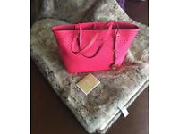 Beautiful vibrant pink Genuine michael Kors Jet Set perforated travel tote