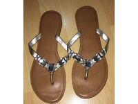 Woman's silver flip flops size 7 marks and spencer
