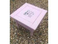 Pink wooden coffee table