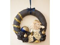 Fabric Christmas wreath with Beardy the snowman and bunches of festive flowers