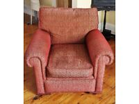 Large, comfy red arm chair. Used, but in clean, good condition. Very strong fabric.