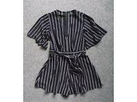 Like new size 8 V-neck jumpsuit Black & white stripe