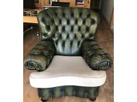 Vintage Chesterfield club chair upholstered in deep buttoned green leather