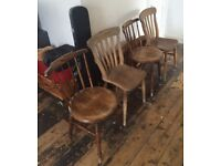 Four beautiful vintage solid wood farmhouse chairs in great condition.