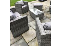 Grey rattan outdoor dining sofa seat set with table