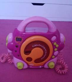Children's karaoke CD player with 2 mics.