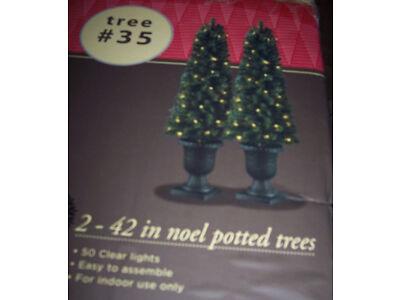 2 Pre-lit Christmas Noel trees in urns,42 in,w/50 lights,indoor trim