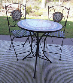 Bistro patio table and two chairs set.