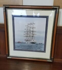 antique brass and oak large picture frame , has picture of boats in