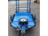 Motor cycle, quad, light machine trailer.