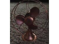 Large copper metal decorative fan