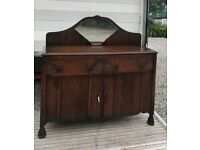 Absolutely beautiful old carved oak mirrored sideboard, original handles and key