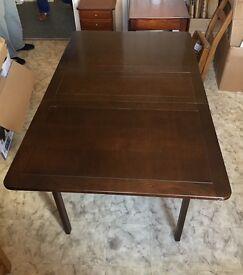 Dark wood folded dining table