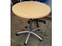 80cm round table, height adjustable. can be used as dining/ office table. In used but good condition