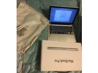 Macbook Pro 2012 Used but good condition Includes Packaging