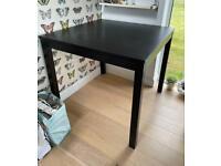 Black IKEA tall square table Bjursta