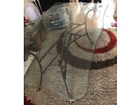 Large scalloped glass dinning table and 7 chairs