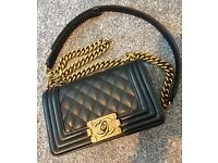 Chanel Le Boy bag. Black leather with antique gold hardware. Mini size. New condition.