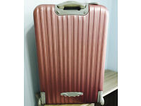 "Quality carbon lightweight large pink suitcase,only used once,costs £125,bargain £45,size H30""&W15"""