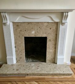 Marble hearth and insert with wood fire surround