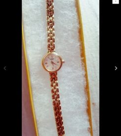Ladies gold plated rotary watch with champagne coloured dial with gold highlights, quartz battery